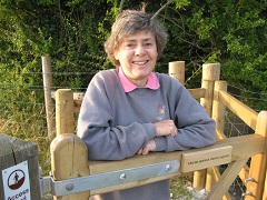 Kate Ashbrook at the kissing gate she installed at Cobstone Hill, Turville, in the Chilterns